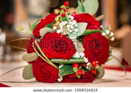 Beautiful wedding bouquet with red roses. Greeting card for 8 March International Women's Day. Close up.
