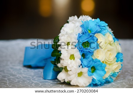 Beautiful wedding bouquet with white and blue flowers - stock photo