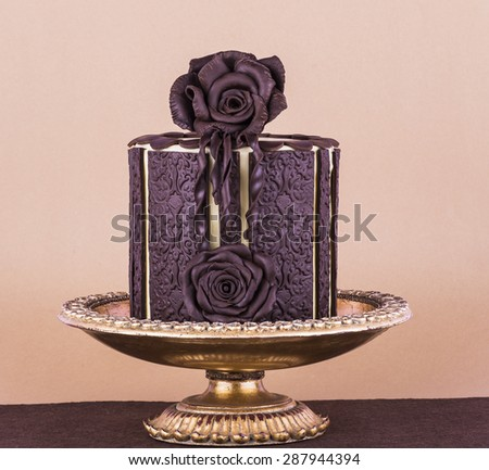 Beautiful wedding cake with chocolate rose design