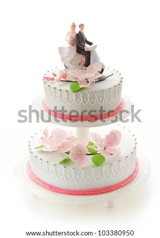 Beautiful wedding cake with girl and boy figurines - stock photo