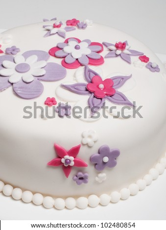beautiful wedding cake with pink purple and white flower design - stock photo