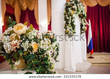 Beautiful wedding ceremony design decoration elements with flowers and chairs - stock photo