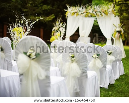 Beautiful wedding ceremony in sunny garden. - stock photo