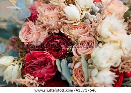 Beautiful wedding colorful bouquet for bride against nature background close-up macro shot. Beauty of colored flowers. Bridal accessories. Female decoration for girl. Details for marriage and for - stock photo