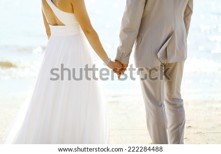 Beautiful wedding couple, bride and groom together near sea  - stock photo