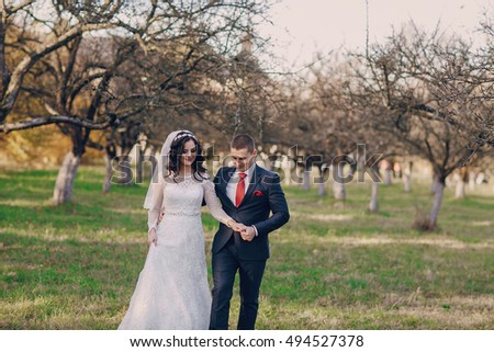 beautiful wedding couple celebrating their wedding day in autumn