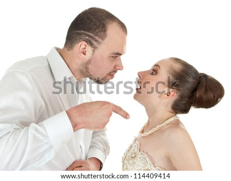 Beautiful  wedding couple  discussing over white background - stock photo