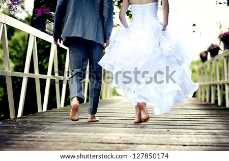 Beautiful wedding couple is enjoying wedding - stock photo