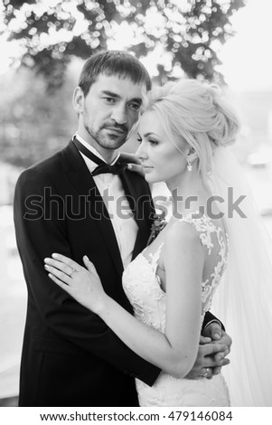 Beautiful wedding couple is standing and hugging each other