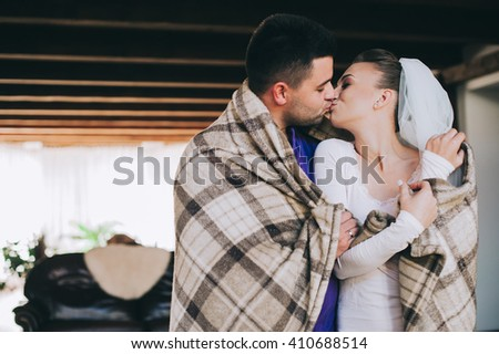 beautiful wedding couple kissing and hugging on wedding morning