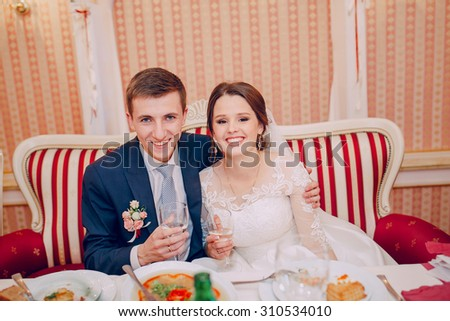 beautiful wedding couple on their wedding in a restaurant - stock photo