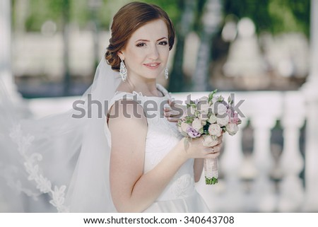 beautiful wedding couple on their wedding walking in the park in excellent weather conditions - stock photo