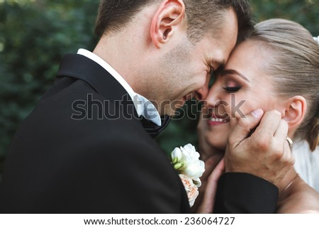 Beautiful wedding couple posing in park