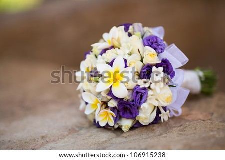 Beautiful wedding exotic bouquet with plumeria - stock photo