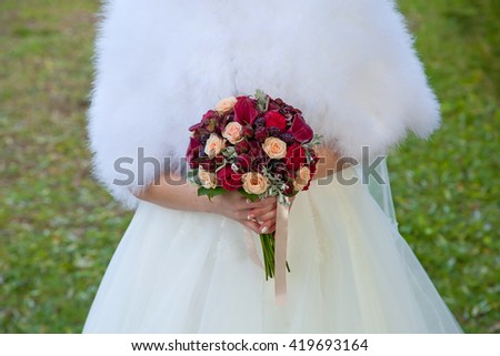 Beautiful wedding flowers in hands, close up