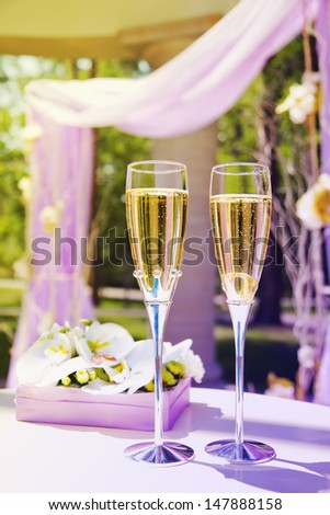 Beautiful wedding gazebo with flower arrangements and Champagne - stock photo