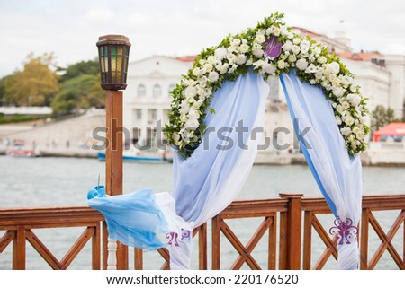 Beautiful wedding gazebo with flower arrangements decorating - stock photo