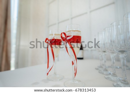 Beautiful wedding glasses of young in red tones. Decor. Wedding.