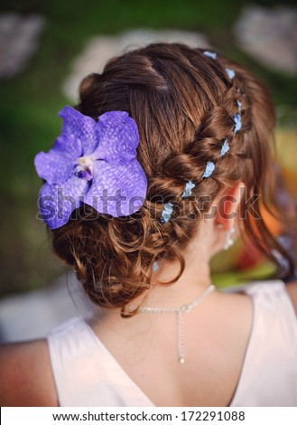 beautiful wedding hairstyle with ribbons and flowers - stock photo