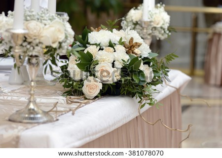 Beautiful wedding restaurant for marriage. White decor for bride and groom. Colorful decoration for celebration. Beauty bridal interior. Bouquet and flowers in hall - stock photo