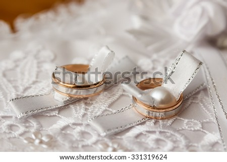 Beautiful wedding rings on blurry background macro