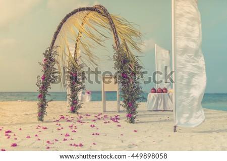 Beautiful wedding setup on the beach. Vintage Instagram effect. - stock photo