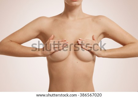 Beautiful well-groomed body of a woman. Caucasian female model during skin care treatment isolated on white background. - stock photo