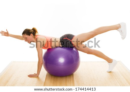 beautiful well trained woman is showing some gymnastics exercises