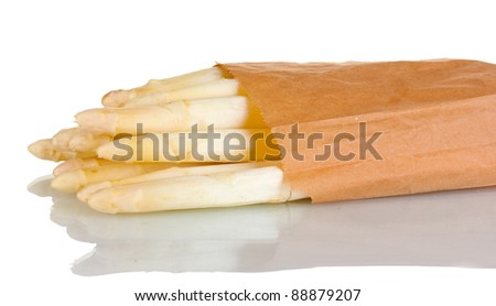beautiful white asparagus in paper bag isolated on white