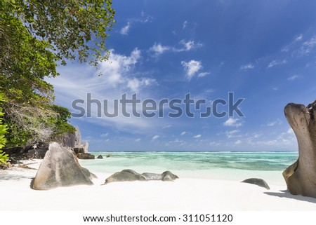 Beautiful white beach Anse Source D'Argent in La Digue, Seychelles with scenic granite rocks - stock photo