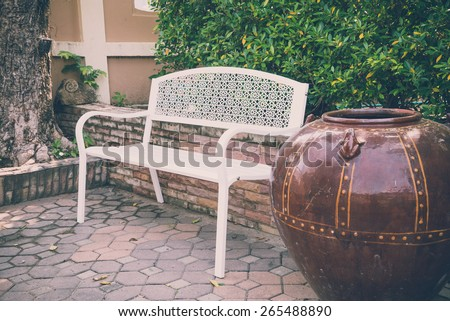 Beautiful white chair in the garden - Vintage effect style - stock photo