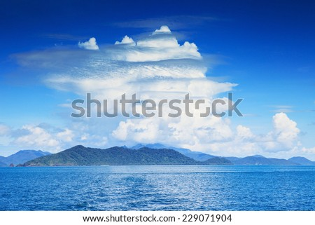 beautiful white clouds on blue sky and clear sea water use as nature background - stock photo
