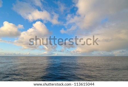 Beautiful white clouds over the Atlantic Ocean - stock photo