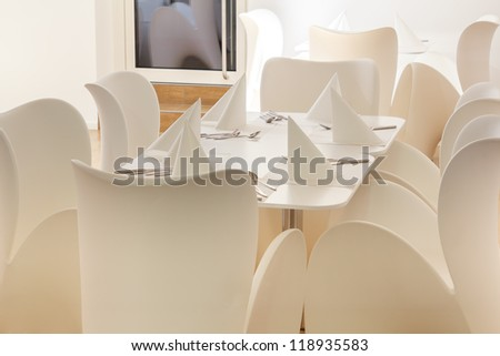 Beautiful white dining area with table and chairs for six
