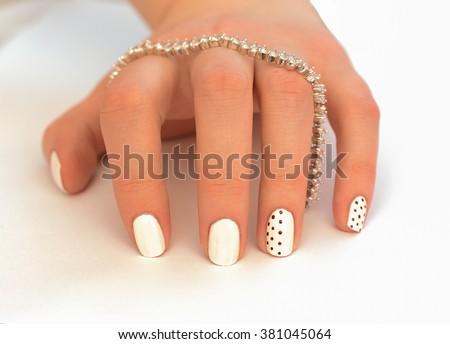beautiful white female manicure. nails - stock photo