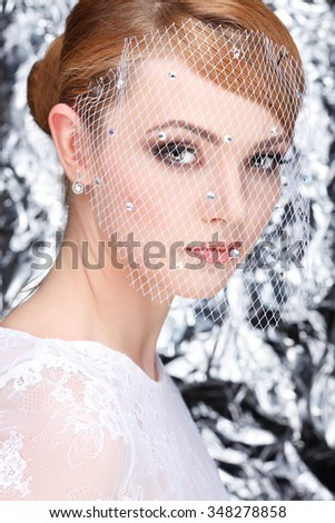 Beautiful white-headed girl in a veil on a silvery background, emotions, cosmetics - stock photo