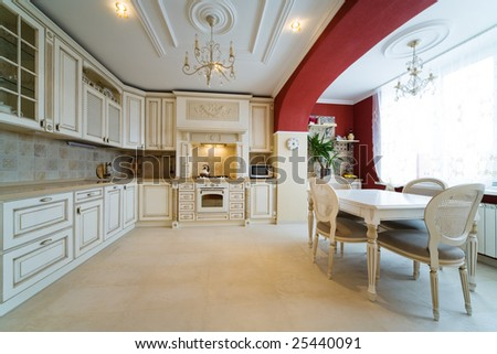 Beautiful white kitchen in a modern apartment - stock photo