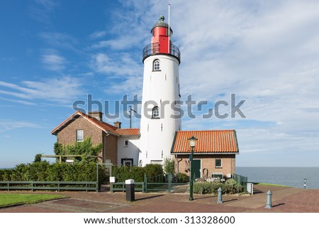 Beautiful white Lighthouse of Urk, Dutch fishing village - stock photo