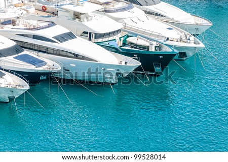 Beautiful white modern yachts at sea port in Nice, France, Europe. - stock photo