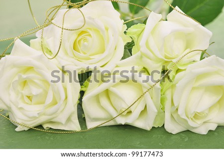 Beautiful white roses  with ribbon for wedding