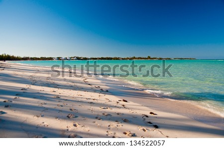 Beautiful white sand beach and blue ocean water on sunny day
