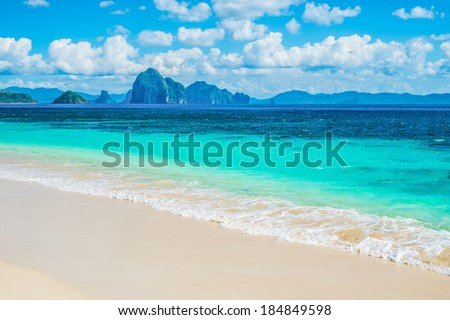 Beautiful White Sand Beach and Blue Sea Wave - stock photo