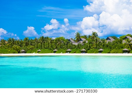 Beautiful white sand beach and Indian ocean - stock photo