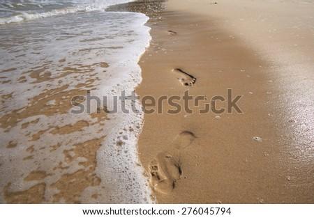 Beautiful white sand beach and tropical turquoise blue sea. - stock photo