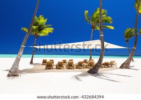 Beautiful white sandy beach of a luxury resort in Punta Cana, Dominican Republic - stock photo
