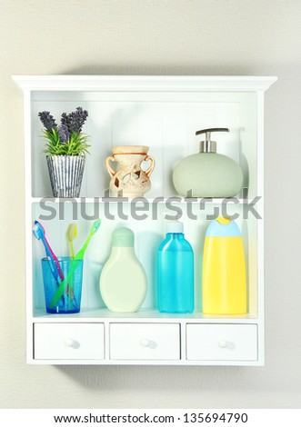 Beautiful white shelves with different bathroom objects