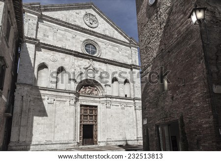 Beautiful white stone made church in a small city in italy. Ta main facade