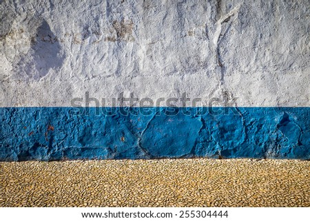 Beautiful white wall background with the vivid blue stripe on the bottom