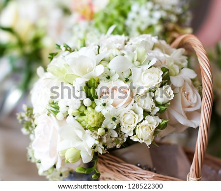Beautiful white wedding bouquets in basket - stock photo
