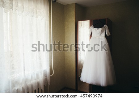 Beautiful white wedding dress for bride indoors. Beauty of bridal gown for marriage